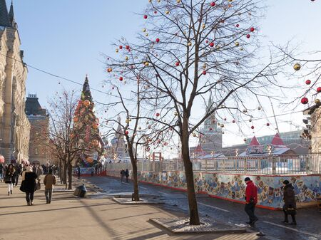 skating rink: Moscow - November 29, 2015: A large outdoor skating rink on Red Square, Christmas ornaments and people walking in the days of winter break 29 November 2015, Moscow, Russia