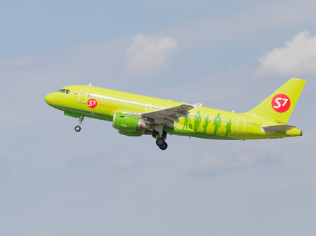 Moscow region - 31 July 2016: Green passenger aircraft Airbus A319-114 S7 Airlines flies to Moscows Domodedovo airport July 31, 2016, Moscow Region, Russia