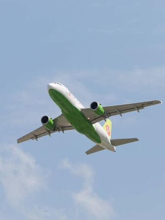 Moscow region - 31 July 2016: A passenger plane Airbus A-319-114 S7 Airlines flies to Moscows Domodedovo airport July 31, 2016, Moscow Region, Russia Editorial