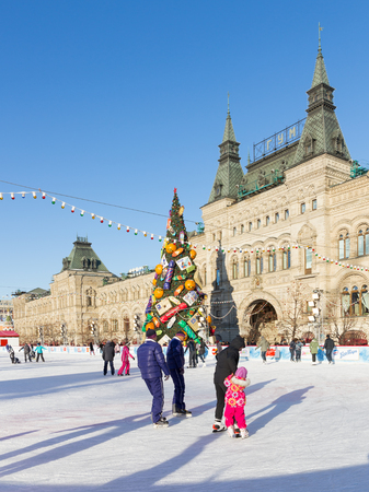 iceskating: Moscow - November 29, 2015: Beautiful Christmas ice rink on Red Square and a lot of people are skating in the holidays, and unusual Christmas tree November 29, 2016, Moscow, Russia