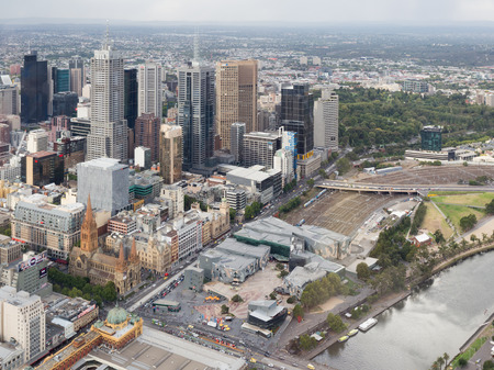 flinders: Melbourne - February 23, 2016: View from the top of the city and see the skyscrapers, Federation Square, the Yarra River and the train station Flinders Street Station February 23, 2016, Melbourne, Australia