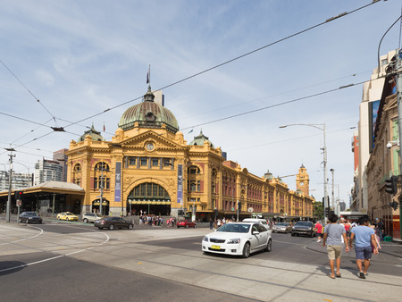 flinders: Melbourne - February 23, 2016: The main entrance to the railway station Flinders Street Station with a clock and a lot of people around February 23, 2016, Melbourne, Australia Editorial