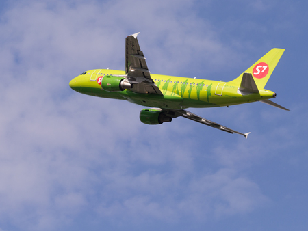 passenger aircraft: The Moscow region - July 31, 2016: Bright green passenger aircraft Airbus A319-114 S7 Airlines takes off and takes place in Domodedovo airport July 31, 2016 Moscow Region, Russia