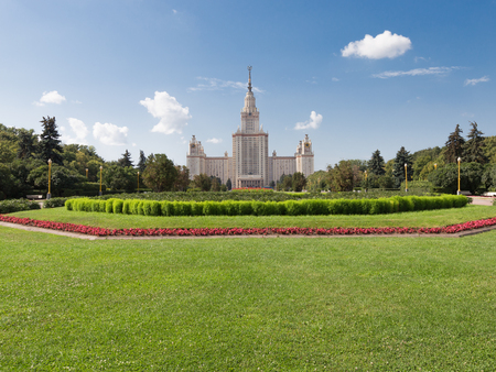 baccalaureate: Moscow - August 11, 2016: Beautiful Moscow State University named after Lomonosov on the Sparrow Hills and beautiful flower beds and lawn in the foreground August 11, 2016, Moscow, Russia Editorial