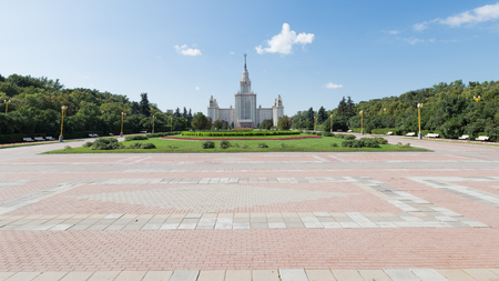 university life: Moscow - August 11, 2016: Beautiful Moscow State University named after Lomonosov on the Sparrow Hills and the alley leading to it August 11, 2016, Moscow, Russia