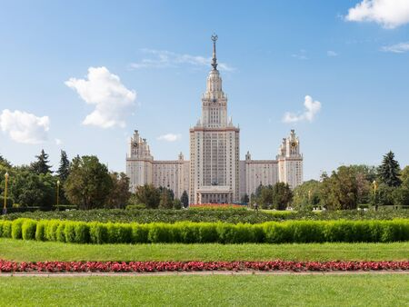 flowerbeds: Moscow - August 11, 2016: Beautiful Moscow State University named after Lomonosov on the Sparrow Hills and flowerbeds and the lawn in the foreground August 11, 2016, Moscow, Russia Editorial