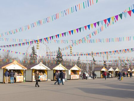enea: Moscow - March 11, 2016: Bright cheerful holiday - Carnival and stalls, selling pancakes and people walk on ENEA Fair March 11, 2016, Moscow, Russia