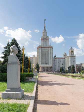 named: Moscow - August 11, 2016: Beautiful Moscow State University named after Lomonosov on the Sparrow Hills and sculpture bust of Lomonosov August 11, 2016, Moscow, Russia