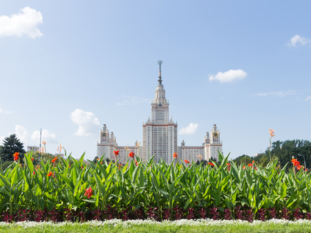 named: Moscow - August 11, 2016: Moscow State University named after Lomonosov on the Sparrow Hills and beautiful red flowers in the foreground, August 11, 2016, Moscow, Russia Editorial