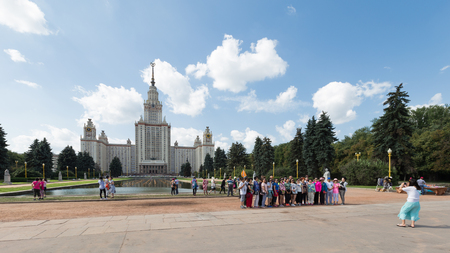 named: Moscow - August 11, 2016: Moscow State University named after Lomonosov on the Sparrow Hills, the park and tourists are photographed August 11, 2016, Moscow, Russia Editorial