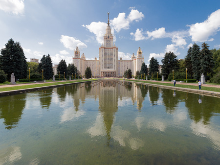 named: Moscow - August 11, 2016: Moscow State University named after Lomonosov on the Sparrow Hills and beautiful reflection in the pond and the good weather August 11, 2016, Moscow, Russia Editorial