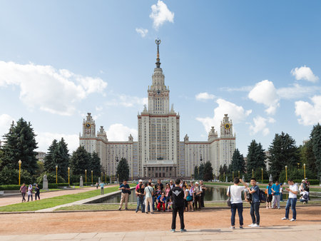 named: Moscow - August 11, 2016: Moscow State University named after Lomonosov on the Sparrow Hills, and a lot of tourists in good weather August 11, 2016, Moscow, Russia Editorial