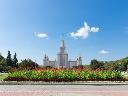 university life: Moscow - August 11, 2016: Moscow State University named after Lomonosov on the Sparrow Hills and beautiful red flowers August 11, 2016, Moscow, Russia