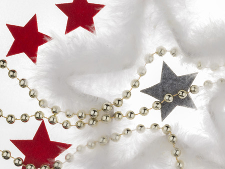 big star: Christmas and New Year decoration - red, gray stars out of soft felt, the big star of the white fluff and gold beads on a white background isolated