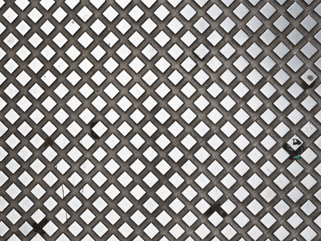 lenticular: large plaid texture with prominent dark metallic silver and diamonds cells concave light background Stock Photo