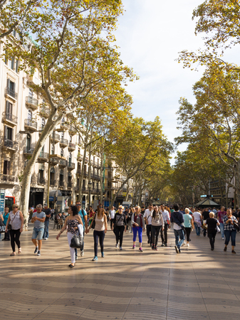 rambla: Barcelona - 10 October 2015: A lot of people happy and tourists stroll on the main tourist street of beautiful Barcelona in Catalonia - Rambla October 10, 2015, Barcelona, Spain Editorial