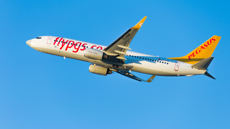 Moscow - August 20, 2015: Large passenger plane Boeing 737-86N (W) Pegasus Airlines flies to Domodedovo airport and on a background of blue sky August 20, 2015, Moscow, Russia Editorial