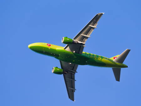 passenger aircraft: Moscow region - July 31, 2016: Bright green passenger aircraft Airbus A319-114 S7 Airlines flies to Domodedovo airport July 31, 2016, Moscow Region, Russia