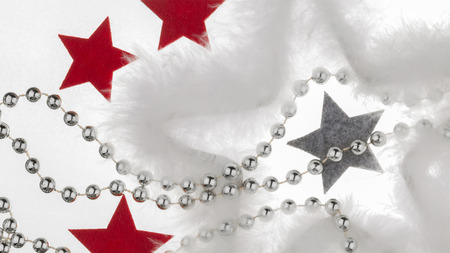 big star: Beautiful Christmas and New Year decoration - red, gray stars of warm felt, the big star of the white fluff and silver beads on a white background isolated Stock Photo