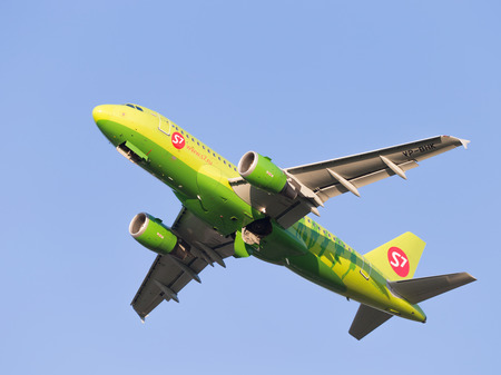 passenger aircraft: Moscow region - 31 July 2016: Green passenger aircraft Airbus A319-114 S7 Airlines flies to Domodedovo airport July 31, 2016, Moscow Region, Russia Editorial