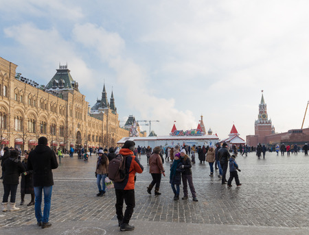 spassky: Moscow - January 7, 2016: Lots of happy people and tourists walk on the Red Square during the Christmas holidays, near the walls of the Kremlin January 7, 2016, Moscow, Russia Editorial