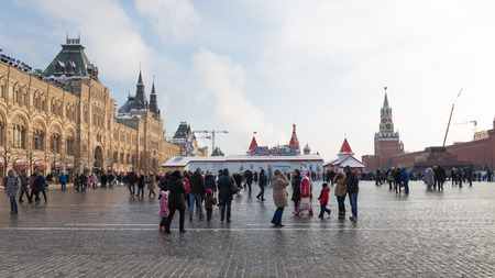 spassky: Moscow - January 7, 2016: A lot of people and tourists walk on the Red Square during the Christmas holidays, near the walls of the Kremlin January 7, 2016, Moscow, Russia Editorial
