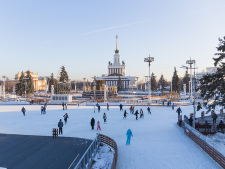 enea: Moscow - November 28, 2015: Lots of happy people ice-skating on the big rink in good weather in winter park ENEA November 28, 2015, Moscow, Russia