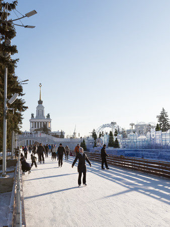 enea: Moscow - November 28, 2015: A lot of people and tourists are skating on the big rink in good weather in winter park ENEA November 28, 2015, Moscow, Russia Editorial