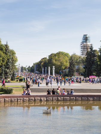 walk in: Moscow - 24 August 2015: Happy people and tourists walk in a beautiful park in the summer of ENEA August 24, 2015, Moscow, Russia Editorial