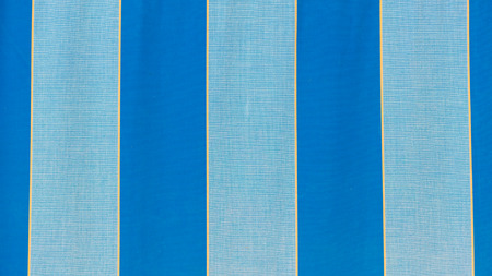 linen fabric: beautiful bright striped linen fabric with blue and thin yellow stripes Stock Photo