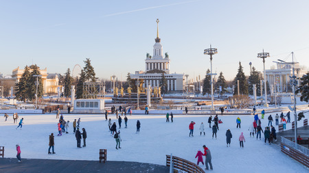 enea: Moscow - November 28, 2015: Lots of happy cheerful people skating on the big rink in good weather in winter park ENEA November 28, 2015, Moscow, Russia Editorial