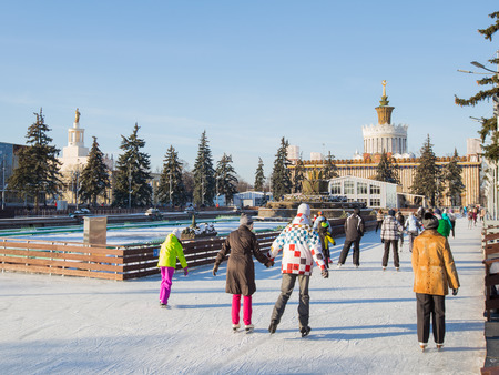 enea: Moscow - November 28, 2015: Lots of happy people and tourists are skating on the beautiful rink in good weather in winter park ENEA November 28, 2015, Moscow, Russia