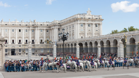 armory: Madrid - 7 October 2015: Tourists gathered around Madrids Royal Palace and a ceremony is held - changing of the guard guardsmen and white horses, October 7, 2016, Madrid, Spain
