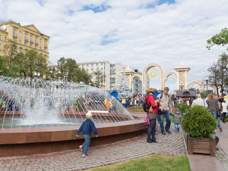 city pushkin: Moscow - September 10, 2016: the City Day in Moscow, and people came to the celebration at Pushkin Square and walk around the fountain September 10, 2016, Moscow, Russia