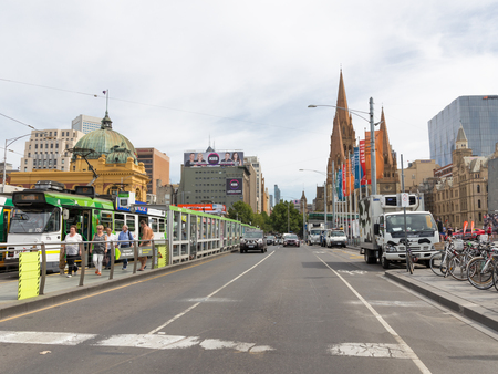 Melbourne - February 23, 2016: City landscape on a hot day about ltny Station Flinders Street Station February 23, 2016, Melbourne, Australia Sajtókép