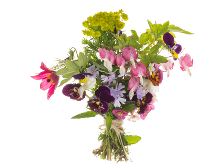 Bright beautiful spring floral bouquet, various varieties and flowers, tied with string, on an isolated white background Stock Photo