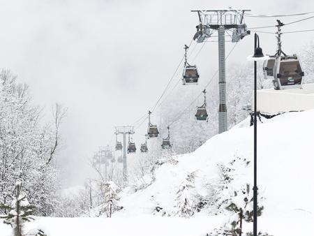 gorki: Sochi - March 28, 2017: Ski lift Gorki City and snow in Estosadok March 28, 2017, Estasadok, Sochi, Russia Editorial