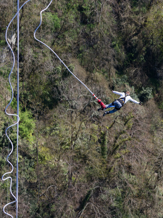 Sochi - April 4, 2017: A brave man with a rubber rope, jumping from the worlds longest pedestrian bridge in the Akhshtyrsky gorge April 4, 2017, Sochi, Russia