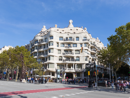 Barcelona - October 10, 2015: Residential building of architect Antoni Gaudi - Casa Mila and many tourists October 10, 2015, Barcelona, Spain