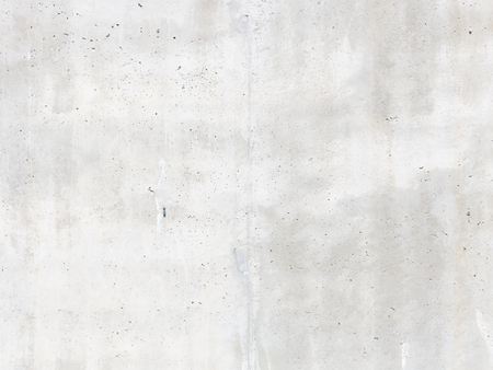 Light gray concrete wall with a rough surface and irregularities