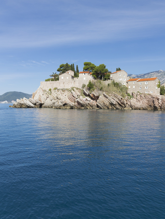 elite: Sveti Stefan - September 24, 2017: Beautiful island shine-Stefan view from the Adriatic Sea, and reflections in the water September 24, 2017, Sveti Stefan, Montenegro Editorial