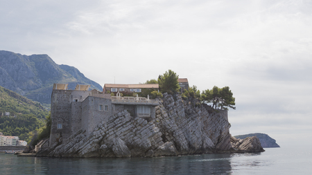 elite: Sveti Stefan - September 24, 2017: The beautiful island of Sveta-Stefan view from the Adriatic Sea, and the sea merges with the sky early in the morning September 24, 2017, Sveti Stefan, Montenegro