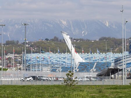 Sochi - March 3, 2017: View of the beautiful cup of the Olympic torch in the Olympic Park and the mountains away March 3, 2017, Sochi, Russia