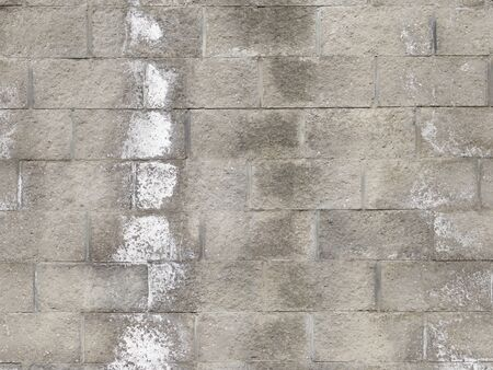 old dirty uneven surface of a wall of gray concrete bricks 版權商用圖片
