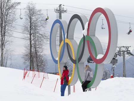 Sochi - March 29, 2017: People are photographed against the backdrop of olympic rings in the Olympic Park in Sochi, March 29, 2017, Sochi, Russia Redactioneel