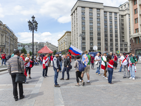 Moscow - June 14, 2018: Happy Russian football fans at the World Cup in Moscow are photographed and rest on June 14, 2018, Moscow, Russia