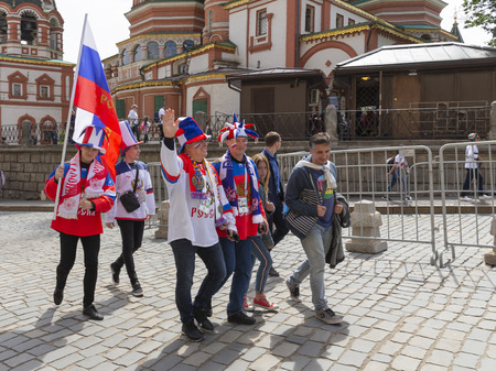 Moscow - June 14, 2018: Football fans from Russia with the Russian flag in Moscow on the days of the World Cup on June 14, 2018, Moscow, Russia