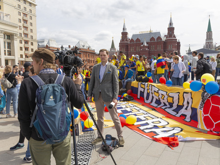 Moscow - June 14, 2018: Journalists shoot a report about the holding of the World Cup in Moscow and football fans from Colombia June 14, 2018, Moscow, Russia Editöryel