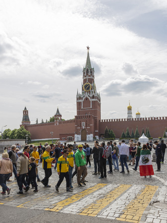 Moscow - June 14, 2018: many people and tourists are walking around the Kremlins Spasskaya Tower in the days of the World Cup and football fans June 14, 2018, Moscow, Russia