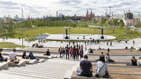 Moscow - June 14, 2018: People walk in the modern beautiful park Zaryadye and a beautiful view of the open-air stage, the city and the Kremlin, vertically June 2018, Moscow, Russia Editöryel